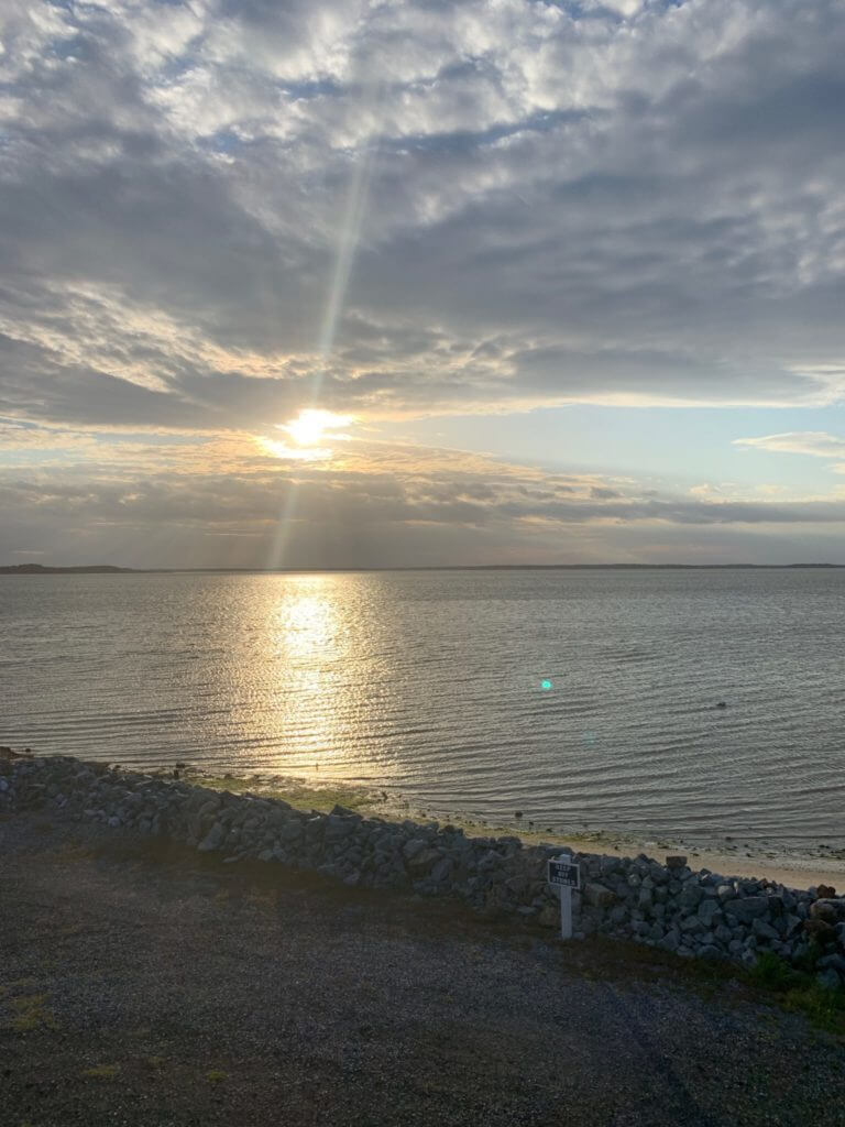 Sun rays shining through clouds at Ocean View, DE