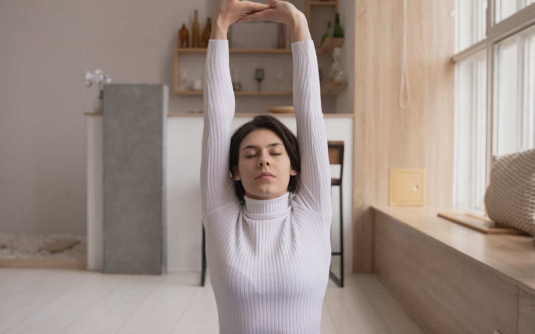 Exercises for women over 50l seated woman stretching
