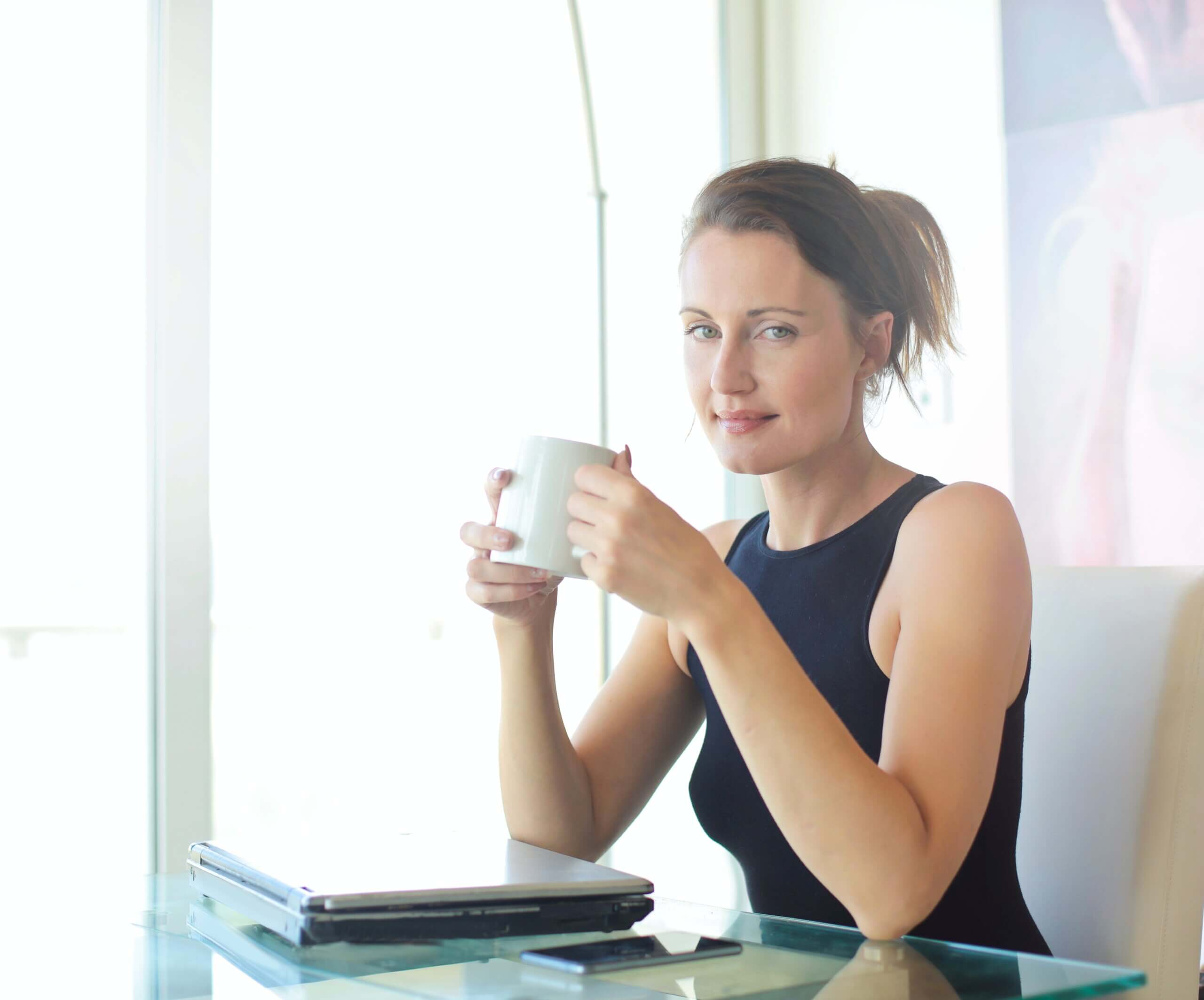 Exercises for woman over 50l seated woman with coffee cup